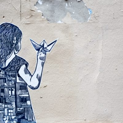 cartoon girl with origami on wall