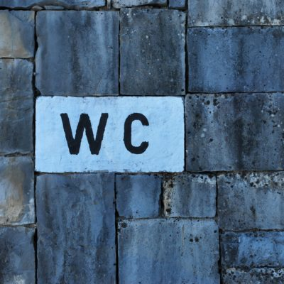 WC sign on wall